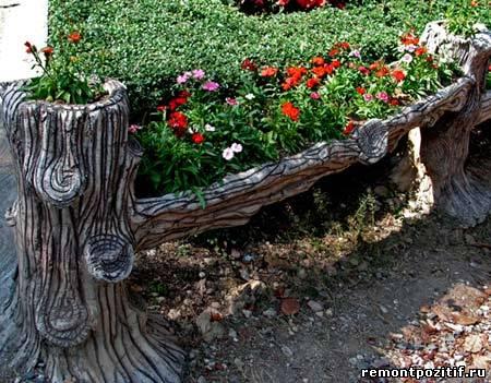 клумба из старого дерева на даче